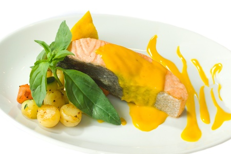 Steamed salmon with mango sauce and vegetables