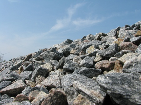 aggregates: Crushed stones in front off blue sky Stock Photo