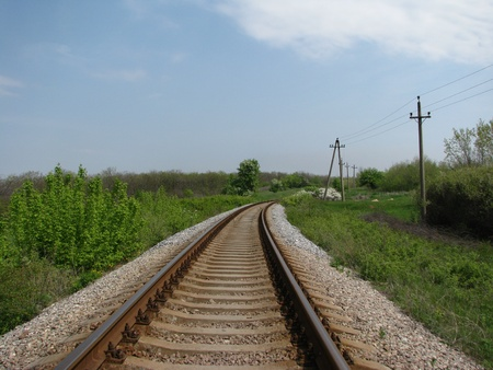 skids: railroad, stretching through the fields into the far
