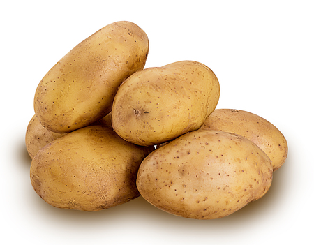 Heap of young potatoes isolated on white background. Clipping Path Фото со стока