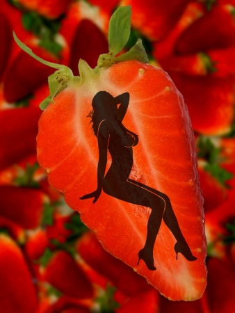 Silhouette of sexual woman on a strawberries background Stock Photo