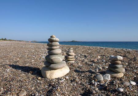 balanced stones on a beach Stock Photo