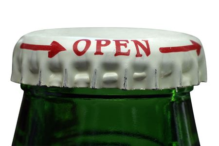 Beer bottle close-up with bottle-cap with clipping path. photo