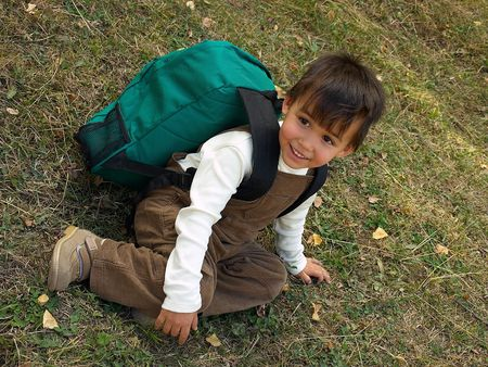 Little funny boy with backpack just come back from school Stock Photo - 3646099