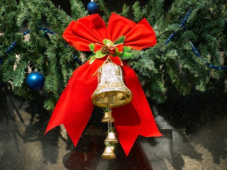 Christmas Bell on christmas-tree photo