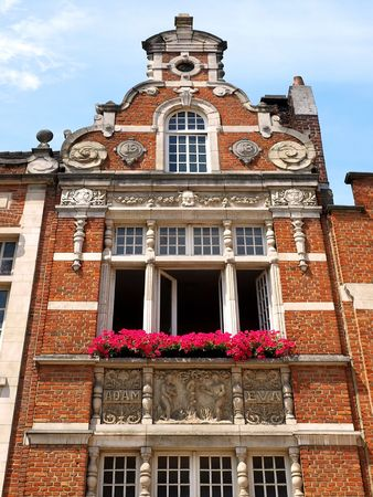 Facade of old Brussels building with classic red brick. photo