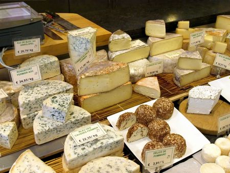Assorted cheeses for sale on french market.