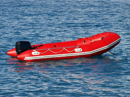 buoyancy: Red Inflatable Lifeboat. Stock Photo