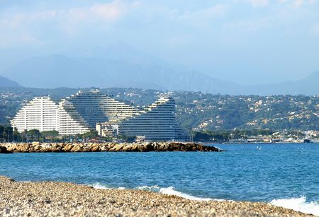 French Riviera Coast. Beach of Antibes. View to front luxury hotel. Stock Photo