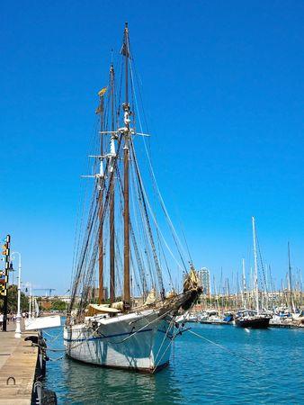 Sailboat anchored at Barcelona Harbor, Spain. photo