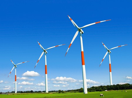 Wind turbines generating electricity on the beautiful green meadow. Stock Photo - 7026169