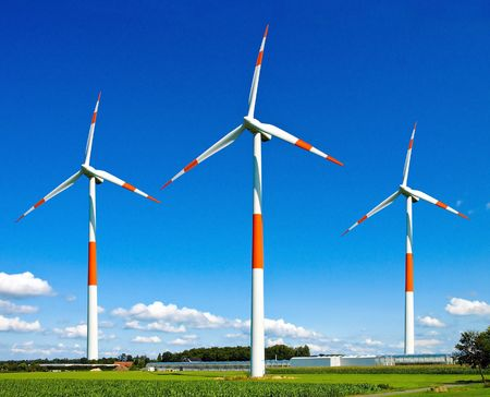 Wind turbines generating electricity on the beautiful green meadow. Stock Photo - 7085216
