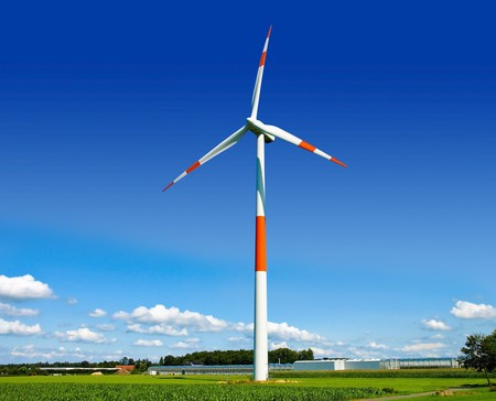 Wind turbine generating electricity on the beautiful green meadow. Stock Photo - 7101069