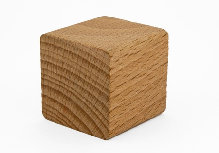 Single wooden cube isolated on white background. Clipping path included. photo
