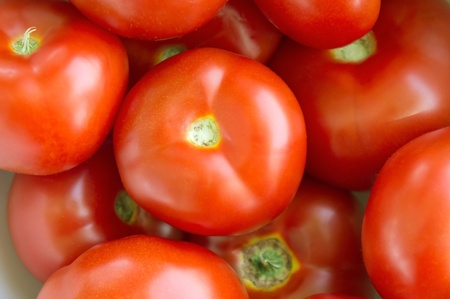 organically: Organically grown of fresh red tomatoes background  Stock Photo