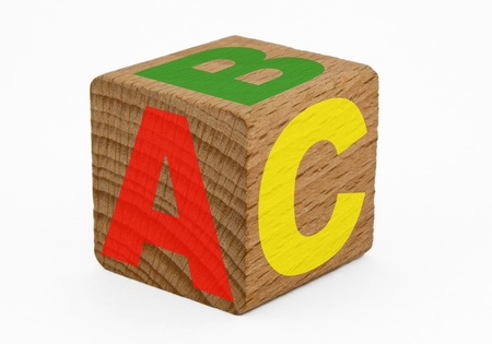 Single wooden cube with ABC isolated on white background. Clipping path included. photo