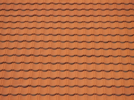 Red clean roof tiles background texture in regular rows. photo