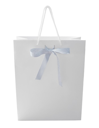 White shopping bag with bow isolated on white. Stock Photo