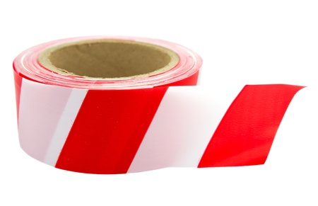 Roll of red white interdiction tape isolated on white.