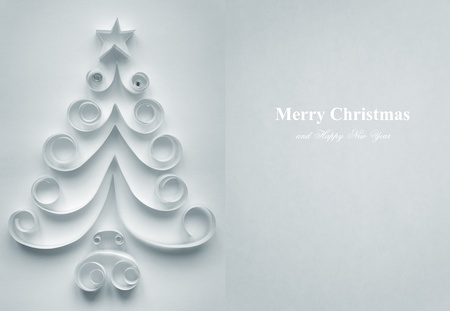 Christmas tree made of paper on white background Stock Photo - 11430111