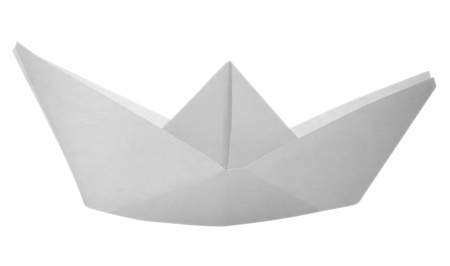 Paper boat made of paper on white background photo