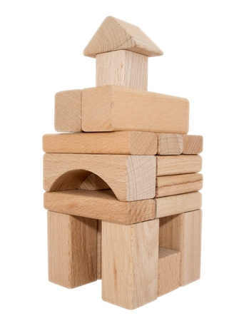 forsale: Block house made of childrens building blocks, isolated on white.