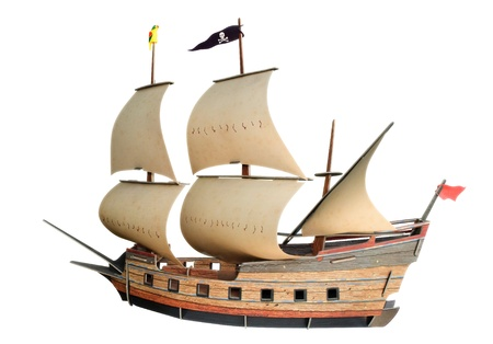 Old ship with sails isolated on a white background.