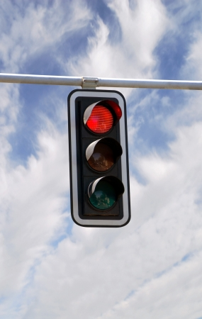 Red traffic lights against blue sky backgrounds with clipping path photo