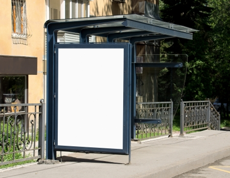 Blank Billboard on Bus Stop for your advertising situated (with work path) photo