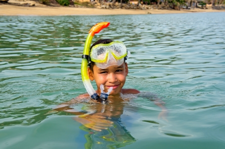 Young boy wearing a mask for diving photo