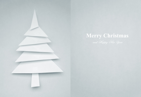 Greeting Card of christmas tree made of paper for your design photo