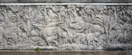 Bas-relief composition of stone elephants in Thailand photo