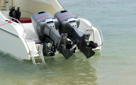 Two speed engines are lifted out of the water photo