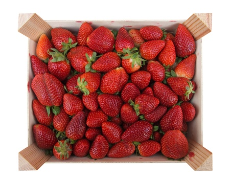 Strawberries in wooden box isolated on white. Clipping path included.  photo