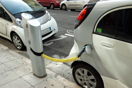 electro: Two electric cars charging on a street in the city of Nice.