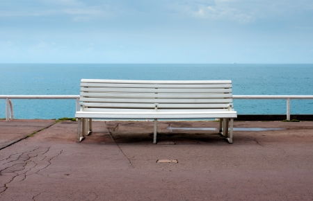 Empty bench overlooking the sea. Promenade des Anglais, Nice, France.  photo