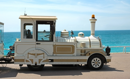 trackless: White trackless train for sightseeing on the Promenade des Anglais in Nice, France Stock Photo