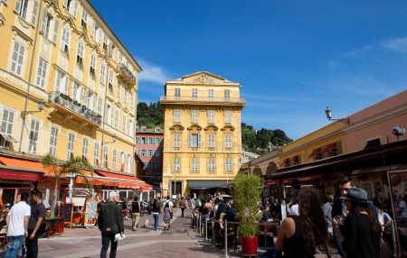 NICE, FRANCE - MAY 4: Old building and a cafe in the Cours Saleya on May 4, 2013 in Nice, France. The Cours Saleya is a place of outdoor restaurants and a market.