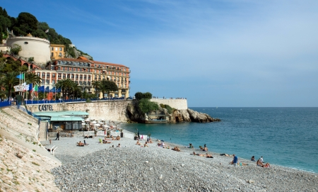 NICE, FRANCE - MAY 4: Citizens and tourists sunbathing enjoying a sunny day on the beach in Angel bay on May 4, 2013 in Nice, France.