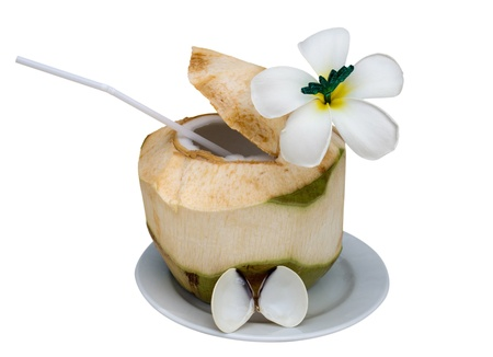 Green coconut with drinking straw isolated on white.  photo