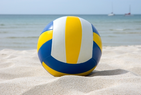 Volley ball on the white sand beach.