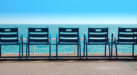 nice  france: Deck Chairs in front of the sea