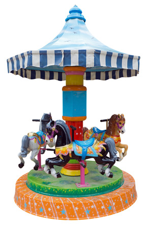 Childrens carousel with horses isolated on white.
