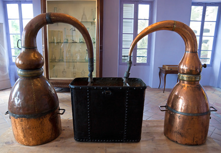 Ancient distiller for the production of perfume in Fragonard factory in Grasse, France Stock Photo
