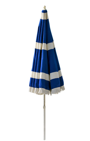 Blue beach umbrella isolated on white. Clipping path included. photo