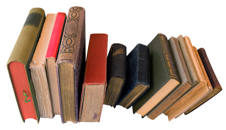 Old books isolated on white. Clipping path included. photo