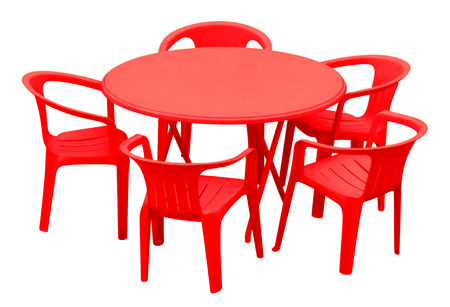 Plastic table and chairs isolated on white. Clipping path included. photo