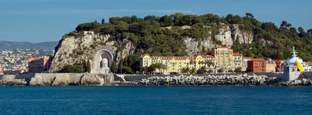 Architecture along Promenade des Anglais.  It is a symbol of the Cote dAzur and was built in 1830 at the expense of the British colony. View from the Mediterranean Sea. photo