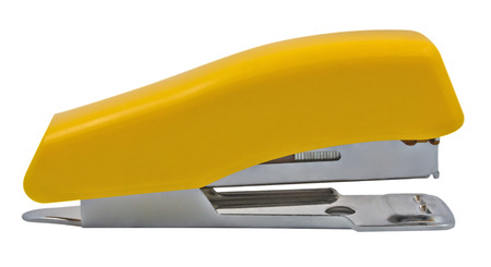 Yellow stapler isolated on white. Clipping path included. photo
