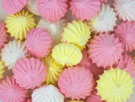 lite food: French vanilla meringue cookies close up background. Stock Photo